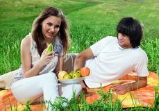 Long-haired girl with fruits and boy Royalty Free Stock Images