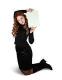 Long haired girl holds an empty poste Royalty Free Stock Photo