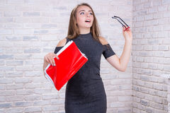 Long-haired girl imitates business administrator with red folder Stock Images