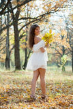 Long-haired girl with oak posy in autumn. Outdoor portrait of long-haired girl with oak posy in autumn royalty free stock photo