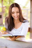 Long-haired girl reads book Royalty Free Stock Photo