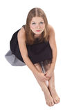 The long-haired girl sitting on the floor Stock Photography