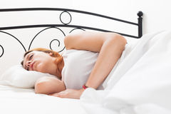 Long-haired girl sleeping on white pillow in bed Stock Images