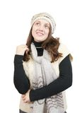 Long-haired girl in sweater and cap Royalty Free Stock Photo