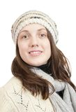 Long-haired girl in sweater and cap Royalty Free Stock Images