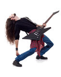 Long haired guitarist is playing a guitar royalty free stock images