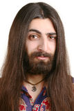 Long-haired hippie man Stock Images