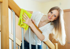 Long-haired housewife cleaning stair railings Stock Photography