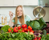 Long-haired housewife cooking with fresh vegetables Stock Photography