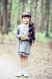 Long-haired Little Girl Walks In Autumn Forest Stock Images