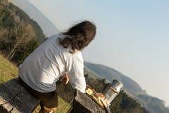 Long-haired man enjoying the idyll Stock Photos