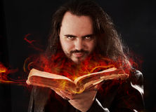 The man with burning book Stock Images