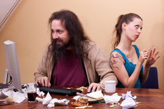 Long haired nerd on the computer with  beautiful woman Stock Photos
