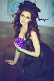 Long Haired Sensual Brunette With A Wreath Of Black Flowers Sitting On The Floor Royalty Free Stock Image