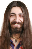 Long-haired smiling hippie man Stock Photography