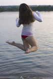 Long haired white woman  jump in water Stock Images