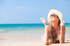 Long haired woman in bikini and straw hat on Royalty Free Stock Photos