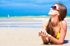 Long haired woman in bikini on tropical beach Royalty Free Stock Photography