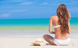 Long haired woman in bikini on tropical beach Stock Images