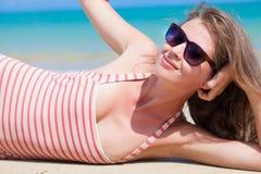 Long haired woman in bikini on tropical beach Stock Photo
