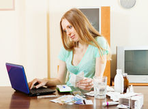 Long-haired woman choosing medication online Royalty Free Stock Image