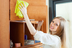 Long-haired woman cleaning furniture Stock Photo