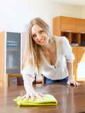 Long-haired woman cleaning table Stock Photo