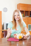 Long-haired woman eating  fruit salad with yoghurt Stock Images