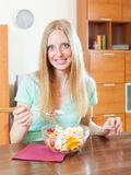 Long-haired woman eating  fruit salad with yoghurt Royalty Free Stock Photography