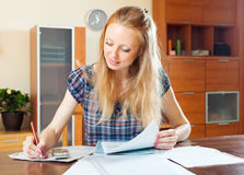 Long-haired woman fills in the questionnaire Stock Photo