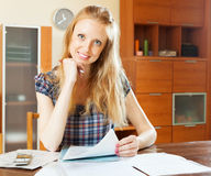 Long-haired woman with financial document Royalty Free Stock Photography