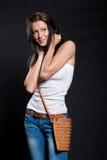 Long-haired woman with handbag Royalty Free Stock Photo