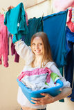 Long-haired woman hanging clothes Royalty Free Stock Photography