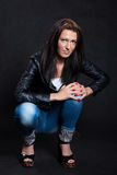 Long-haired woman in a leather jacket Royalty Free Stock Photography