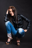 Long-haired woman in a leather jacket stock photo