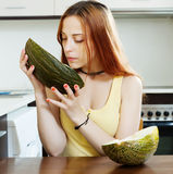 Long-haired woman with ripe melon Stock Photo