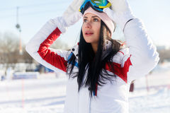 Long-haired woman in ski suit Stock Photography