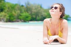Long haired woman in straw hat in bikini on Stock Photo