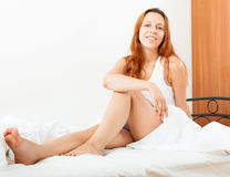 Long-haired woman wakes up. In her bed Royalty Free Stock Photo