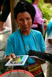The long-haired woman of the Yao people sells souvenirs to tourists. stock photos