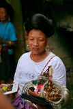 The long-haired woman of the Yao people sells souvenirs to tourists. stock photography