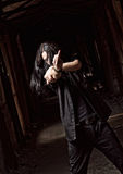 Long-haired young man making offensive gesture (middle finger) Stock Photography
