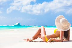Long haired young woman in bikini and sunglasses Royalty Free Stock Image