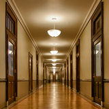 Long hallway of classrooms. Hallway in the David Kinley Hall building on the campus of the University of Illinois in Urbana, Illinois Stock Photos