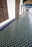 Long hallway with mosaic tiled floor in a Moroccan palace Royalty Free Stock Images