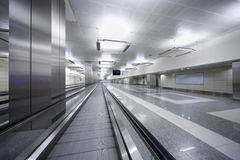 Long hallway with track for passengers in airport. Royalty Free Stock Photography