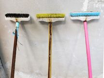 Long Handle Cleaning Brush Leaning against the old wall stock photo