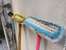 Long handle cleaning brush Leaning against the old wall stock image