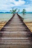 Long hardwood bridge over the sea Stock Photo