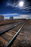 The long haul ahead. A set of train tracks stretching to infinity with a blue sky and Royalty Free Stock Photos
